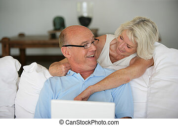 Senior couple with a laptop