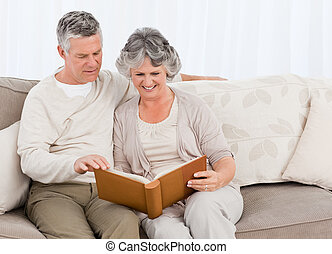 Senior couple with a photo album