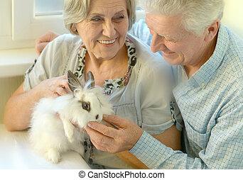 Senior couple with a rabbit