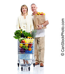 Senior couple with a shopping cart.