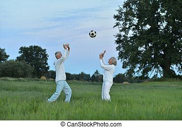 Senior couple with ball