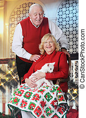 Senior Couple with Cat at Christmastime