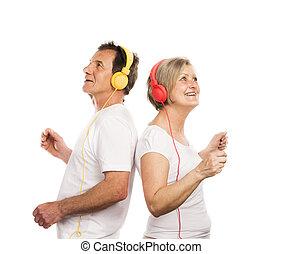 Senior couple with headphones