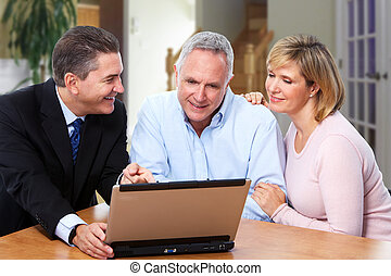 Senior couple with insurance agent. - Senior couple talking ...