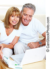 Senior couple with laptop.