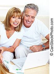 Senior couple with laptop.