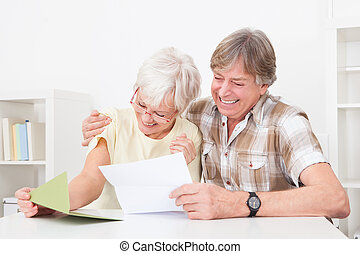 Senior Couple With Letter