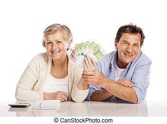Senior couple with money - Senior couple counting money at...