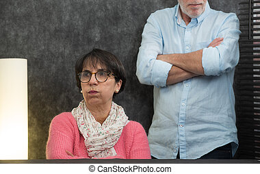 senior couple with problems at home
