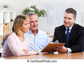 Senior couple with real estate agent.