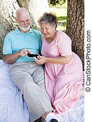 Senior Couple with Smart Phone