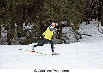 Senior cross country skiing during the winter - Senior at...