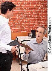 Senior customer ordering in a restaurant