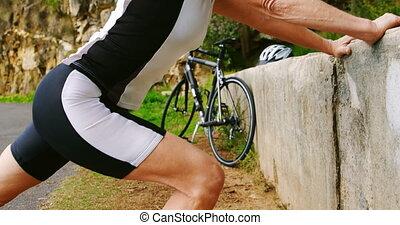 Senior cyclist exercising on a sunny day 4k