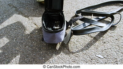 Senior cyclist using air pump on a road 4k - Senior cyclist ...