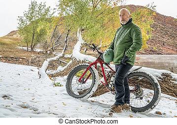 senior cyclist with a mountain fat bike