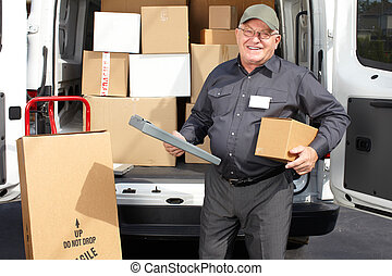 Senior delivery man with parcel near truck.