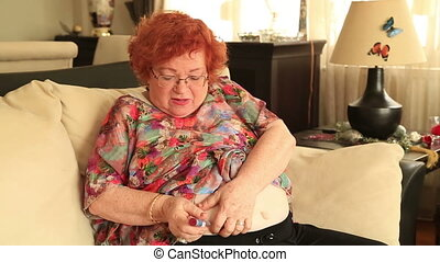 Senior diabetes patient injecting insulin - Senior...