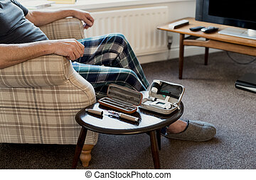 Senior Diabetic Man at Home - Senior man is relaxing in the ...