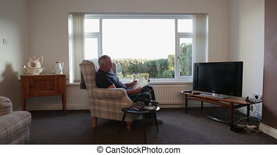 Senior Diabetic Man Relaxing at Home - Senior diabetic man...
