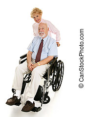 Senior Disabled Man & Wife - Senior man in a wheelchair with...