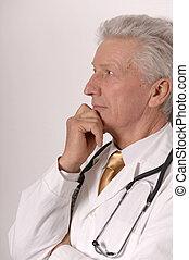 senior doctor on white