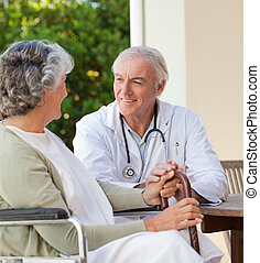 Senior doctor talking with his matu