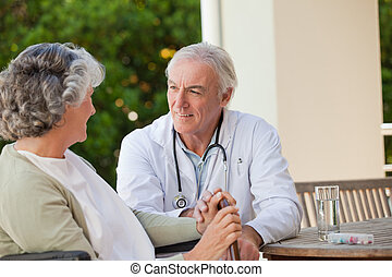Senior doctor talking with his matu