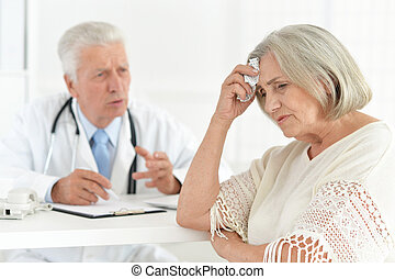 Senior doctor with a elderly patient