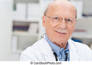 Senior doctor with a mustache and glasses