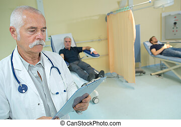 senior doctor with clipboard