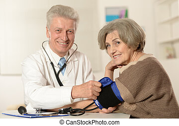 Senior doctor with elderly patient