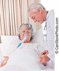 Senior doctor with his sick patient