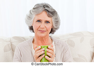 Senior drinking a cup of tea