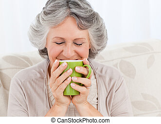 Senior drinking a cup of tea at home