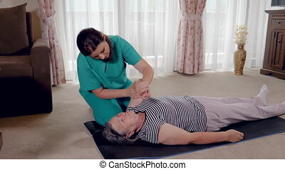 Senior during rehabilitation with physiotherapist after an...