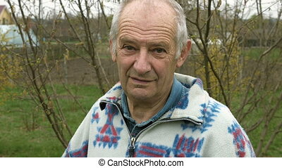 Senior elderly aged old man portrait outdoors