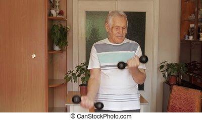 Senior elderly caucasian man doing weight lifting dumbbell ...
