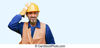 Senior engineer man, construction worker terrified and nervous expressing anxiety and panic gesture, overwhelmed