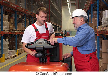 senior engineer training a newly hired