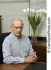 senior executive in office