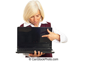Senior executive woman pointing to laptop