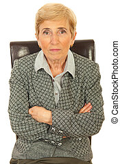 Senior executive woman sitting on chair