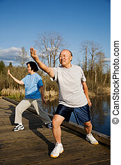 Senior exercise - A shot of a senior couple practicing...