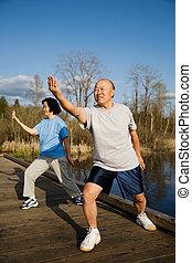 Senior exercise - A shot of a senior couple practicing...