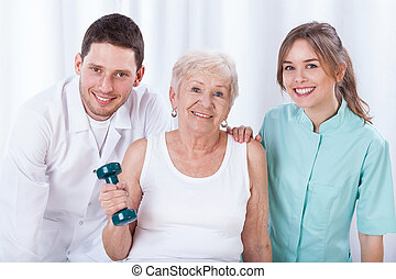 Senior exercising with dumbbell