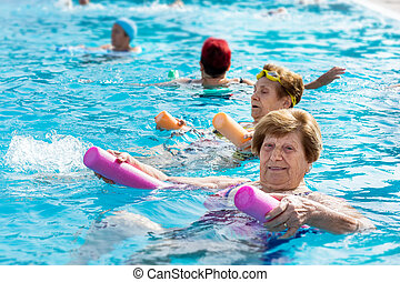 Senior female aqua gym session.