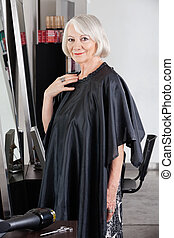 Senior Female Customer Standing At Salon