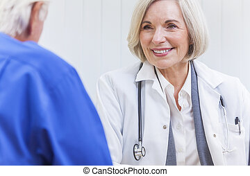 Senior Female Doctor With Male Patient