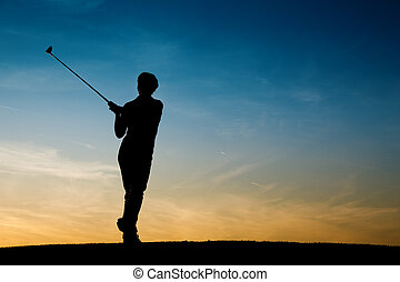 Senior female golf player at sunset